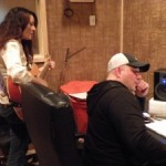 mr mig working in the studio on a song with recording artist